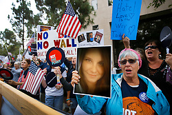 August 15, 2017 - Vista, California, U.S. - SANDY ATKINSON of Oceanside holds a photo of Heather Heyer at the weekly rally in front of Congressman Darrell Issa's Vista office, protesting the congressman, and President Trump. Heyer, protesting at white supremacy rally in Charlottesville, Virginia,  was killed last Saturday, after a car crashed into demonstrators. (Credit Image: © Howard Lipin/San Diego Union-Tribune via ZUMA Wire)