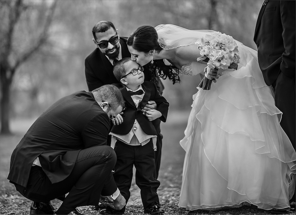 A bride kisses her son prior to her wedding ceremony held at Meadows Banquet Hall Hellertown, Pennsylvania.