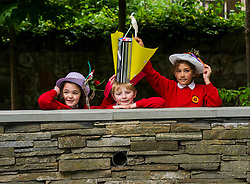 Pictured: Beda Johnson (7), Harris Binnie (8) and Naeema Ahmd Aran (8) were having fun with the crazy hats.<br /> Pupils from Royal Mile Primary tried  on crazy hats made by a performer from company Mischief Labas, which is holding a hat-making workshop at the Imaginate opening weekend on May 28-29<br /> <br /> <br /> <br /> Ger Harley | EEm 26 May 2016
