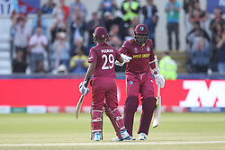 July 1, 2019 - Chester Le Street, County Durham, United Kingdom - Nicholas Pooran of West Indies celebrates with Sheldon Cottrell after scoring a hundred during the ICC Cricket World Cup 2019 match between Sri Lanka and West Indies at Emirates Riverside, Chester le Street on Monday 1st July 2019. (Credit Image: © Mi News/NurPhoto via ZUMA Press)