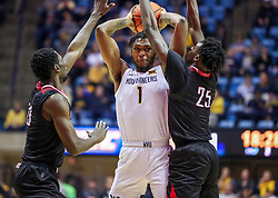 Dec 14, 2019; Morgantown, WV, USA; West Virginia Mountaineers forward Derek Culver (1) attempts to make a pass and is pressured by Nicholls State Colonels guard Andre Jones (13) and Nicholls State Colonels forward Warith Alatishe (25) during the second half at WVU Coliseum. Mandatory Credit: Ben Queen-USA TODAY Sports
