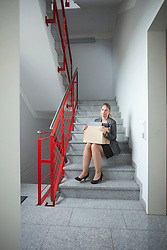 Stairs sitting sad woman jobless unemployed