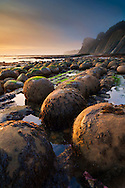 Sunset light on geological concretions at Bowling Ball Beach, Mendocino County, California