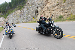 Bob Curatto and Tommy Andriessan on the Annual Cycle Source and Michael Lichter Rides (combined this year) left from the new Broken Spoke area of the Iron Horse Saloon during the Sturgis Black Hills Motorcycle Rally. SD, USA.  Wednesday, August 10, 2016.  Photography ©2016 Michael Lichter.