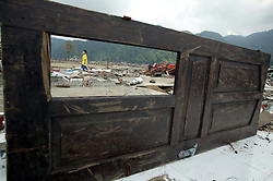 All that is left of Leupung Village. Oxfam works in Leupung on a number of projects including livelihoods, shelter and others.<br />Oxfam promotes the collection and reuse of usable housing materials such as this window grill or wooden items such as doors.