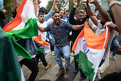© Licensed to London News Pictures. 16/06/2019. Manchester, UK. India supporters celebrate their win . Cricket fans watch India play Pakistan on a live screen in Cathedral Gardens , as the the two sides meet in the ICC Cricket World Cup at Old Trafford . Photo credit: Joel Goodman/LNP