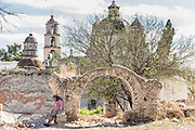 Religious pilgrims rest outside the Sanctuary of Atotonilco an important Catholic pilgrimage site in Atotonilco, Mexico.