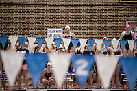 Swimmers watch girls 200 yard Freestyle Relay action during the Division II NHIAA Swimming and Diving Championships held at UNH Sunday.   (Karen Bobotas/for the Concord Monitor)