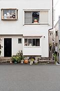house with large dolls in window Japan Yokosuka
