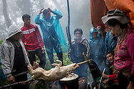 Hmong porters prepare dinner for their hikers during their climb to the top of Mt. Fansipan on Cat Cat route, Lao Cai Province, Southeast Asia