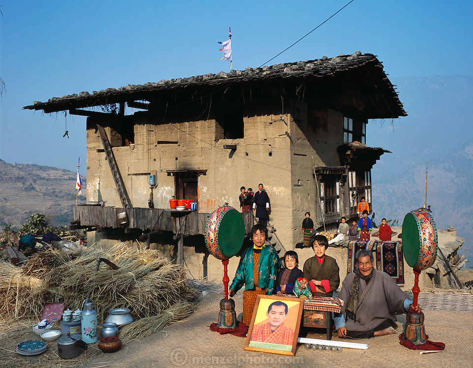 From coverage of revisit to Material World Project family in Bhutan, 2001. Nalim and Namgay's family, with whatever new possessions they have acquired since the shooting of the photograph of the family with all of its possessions for Material World: A Global Family Portrait.