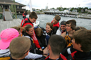 Hull, MA 05/04/2010.The Nor'easters get together before heading back into the water after a weather delay during practice on May 4..Alex Jones / The Patriot Ledger