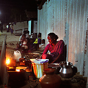 A woman sells roti bread in an emergency shelter in Nagappattinam, on the tsunami-hit southeastern coast of India..The December 26, 2004 tsunami killed thousands of people along this coast, smashing boats, roads and houses and tearing thousands of families apart. .Picture taken February 2005 in Nagapptinam, Tamil Nadu, India, by Justin Jin