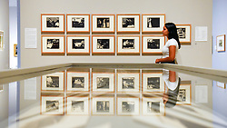 """© Licensed to London News Pictures. 27/06/2019. LONDON, UK.  A staff member views """"Intimacies (Les Intimités)"""" 18997-98, a series of woodcuts by Félix Vallotton. Preview of """"Félix Vallotton:  Painter of Disquiet"""", an exhibition of paintings and prints Swiss artist Félix Vallotton at the Royal Academy of Arts.  Around 100 works are on show 30 June to 29 September 2019.  Photo credit: Stephen Chung/LNP"""