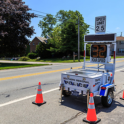 Shrewsbury, PA – June 25, 2016: A self-contained radar unit operated by police checks and displays motorists speed on the Susquehanna Trail in York County.