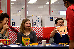WHYY's Taylor Allen, Erin Reynolds and Diana Lu at the winter fest celebration at the Free Library branch in Olney, on December 16, 2018. (Bastiaan Slabbers for WHYY)