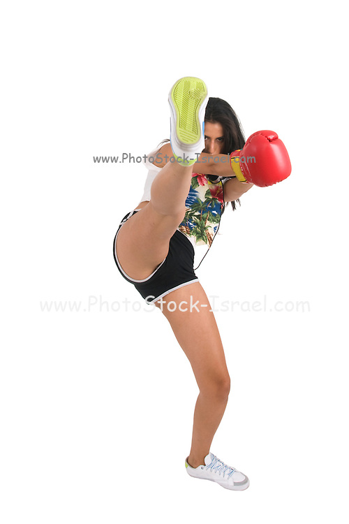 Female kick boxer in a park