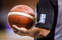Basketball Ball in a referees hand, August 2021 in Debrecen, Hungary, Slovenia. Photo by Vid Ponikvar / Sportida