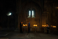Armenians light candles and pray at the church of Surb Hovhannes Mkrtich (St. John the Baptist) at Gandzasar Monastery in Nagorno-Karabakh. Dating from the fifth century, the monastery is one of the most important in Karakh.