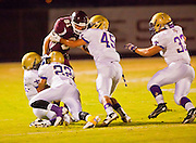 23 SEPTEMBER 2011 - SCOTTSDALE, AZ: Desert Mountain's Mark Andrews (CQ) 81 gets wrapped up by a whole passel of Notre Dame players 1st qtr at Desert Mountain High School in Scottsdale. Desert Mountain played Notre Dame in Desert Mountain's homecoming high school football game.    PHOTO BY JACK KURTZ