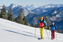 Skiers on snowcapped mountain