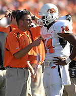 Oklahoma State head coach Mike Gundy talks with quarterback Bobby Reid during a time out against Kansas State at Bill Snyder Family Stadium in Manhattan, Kansas, October 7, 2006.  The Wildcats beat the Cowboys 31-27.<br />