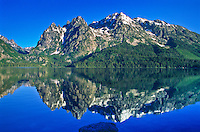 Reflections of 11,938 ft. Mount St. Johns in Genny Lake.  Grand Teton National Park.  Wyoming, USA