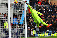 Robbie Brady of Burnley (not in pic) scores from a free-kick as Chelsea Goalkeeper Thibaut Courtois is unable to keep it from hitting the back of the net. Premier league match, Burnley v Chelsea at Turf Moor in Burnley, Lancs on Sunday 12th February 2017.<br /> pic by Chris Stading, Andrew Orchard Sports Photography.