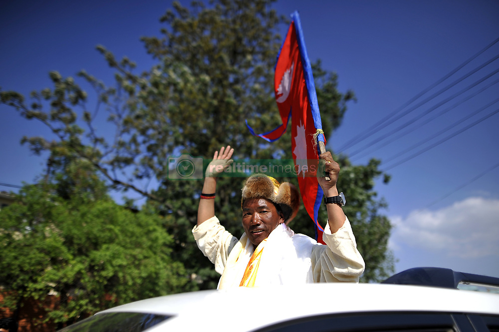 May 25, 2019 - Kathmandu, NP, Nepal - 49yr old Nepali mountaineer Kami Rita Sherpa, who broke his own world record for the most Everest summits, wave hand towards relatives and media after arrives in Tribhuvan International Airport in Kathmandu, Nepal on Saturday, May 25, 2019. Kami Rita Sherpa broke his own world record for the most Everest summits on 21st May, 2019 by reaching the world's highest peak for the 24th time via S Col- SE Ridge. (Credit Image: © Narayan Maharjan/NurPhoto via ZUMA Press)