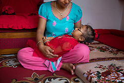 Even a goddess, 2-year-old Resuka Maharjan, the Kumari of Kilagal, needs to rest. It's believed that if Resuka and the Royal Kumari of Kathmandu, who lives nearby, ever see each other, their souls will leave their bodies.