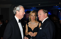 Left to right, the DUKE OF MARLBOROUGH, the COUNTESS OF DERBY and ANDREW PARKER BOWLES at the Cartier Racing Awards held at the Four Seasons Hotel, Hamilton Place, London W1 on 16th November 2005.<br />