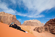 Yoesun Lim relaxes on a red sand dune in Wadi Rum, Jordan.