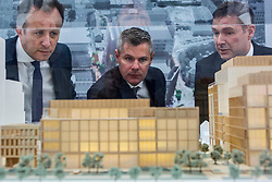 Finance Secretary Derek Mackay, centre, with Charlie Smith, managing director of Scottish Development International, left, and Scott Stewart, head of Barclays Scotland looking at a model of the Barclays Bank development at Tradeston, Glasgow. Pic: Terry Murden @edinburghelitemedia
