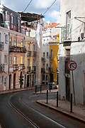 Electric tram navigates the narrow streets in the old town, Lisbon, Portugal