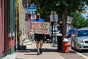 "A demonstrator at the Mifflinburg Pride Event holds a sign reading ""Matt 22:39 Love thy neighbor as thyself."""