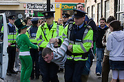 Gardai arresting youth, Temple Bar, Dublin, St. Patrick's Day, 2009