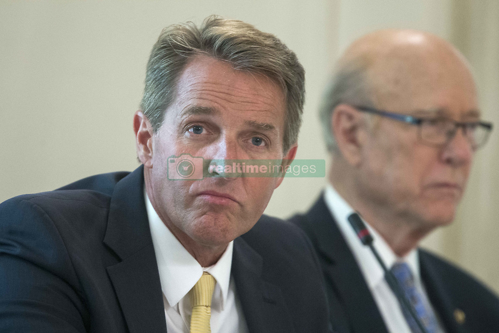 July 19, 2017 - Washington, District of Columbia, United States of America - Republican Senator from Arizona Jeff Flake (L) and Republican Senator from Kansas Pat Roberts (R) attend a lunch with members of Congress hosted by US President Donald J. Trump (not pictured) in the State Dining Room of the White House in Washington, DC, USA, 19 July 2017..Credit: Michael Reynolds / Pool via CNP (Credit Image: © Michael Reynolds/CNP via ZUMA Wire)
