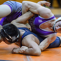 Miyamura Patriot AJ Starkovich overpowers Kirkland Central Bronco Isaac Thomas Wednesday at Gallup High School.