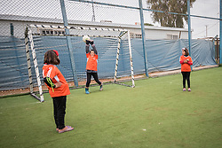 20 February 2020, Za'atari Camp, Jordan: A girl tries, and fails, to save a shot during football practice for girls in the Peace Oasis, a Lutheran World Federation space in the Za'atari Camp where Syrian refugees are offered a variety of activities on psychosocial support, including counselling, life skills trainings and other activities.