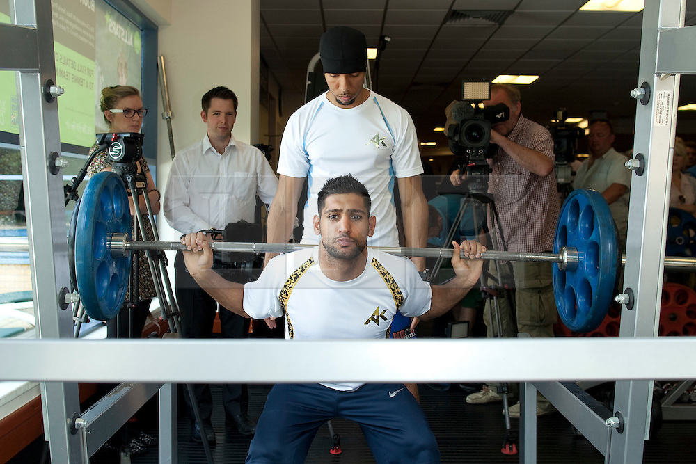 © Licensed to London News Pictures. 30/05/2012. Bolton, UK. Amir Khan holds a workout photocall in Bolton ahead of his stint as an Olympic torchbearer on 31st May. He works out with help from coach Ruben Tabares. Photo credit : Joel Goodman/LNP