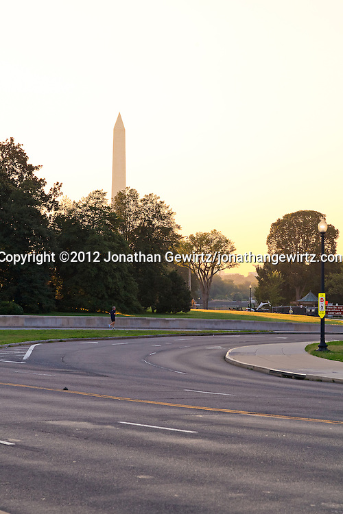 An early morning view of Lincoln Memorial Circle and the Washington Monument. WATERMARKS WILL NOT APPEAR ON PRINTS OR LICENSED IMAGES.