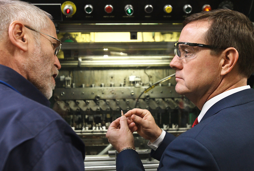 Steve Hornady, left, president of Hornady Manufacturing, goes over part of the ammunition manufacturing process with Lt. Gov. Rick Sheehy Wednesday in Grand Island. Lt. Gov. Sheehy is also visiting other manufacturing businesses in central Nebraska over the next few days. (Independent/Matt Dixon)