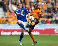 Football - The Championship- Wolverhampton Wanderers v Leicester City -  Wolves' Bakary Sako and Leicesters'Ritchier De Laet battle for the ball  at Molineux