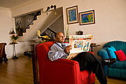 Bejoy George, an IT cosultant relaxes at home before heading to work, Bangalore, India