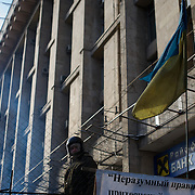January 26, 2014 - Kiev, Ukraine: A antigovernment protestor monitors one of the barricades outside Maidan. (Paulo Nunes dos Santos)