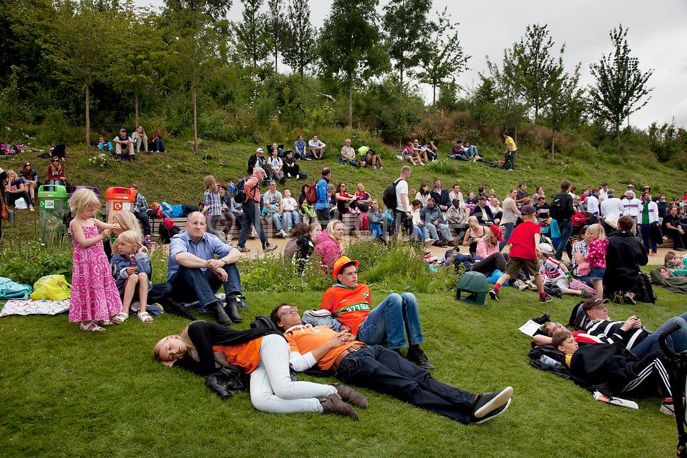 London; English; England; Britain; British; UK; United; Kingdom; Michael; Mike; Kemp; Olympics; Olympic; Park; Games; 2012; crowd; crowds; fans; landscaping; relax; sleep; sleeping.