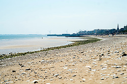 Bridlington North Beach looking back towards Bridlington with the big wheel and wind turbines visible on the horizon<br /> <br />   05 July 2018 <br />   Copyright Paul David Drabble<br />   www.pauldaviddrabble.co.uk