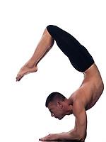 caucasian man scorpion pose Vrschikasana gymnastic acrobatics isolated studio on white background