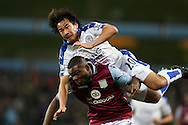 Shinji Okazaki of Leicester city takes a tumble over Jores Okore of Aston Villa.Barclays Premier league match, Aston Villa v Leicester city at Villa Park in Birmingham, The Midlands on Saturday 16th January 2016.<br /> pic by Andrew Orchard, Andrew Orchard sports photography.