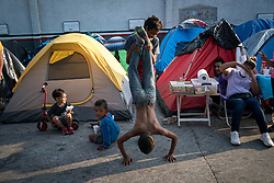 Children play in an informal camp for asylum seekers in Tijuana, Mexico at the US border.